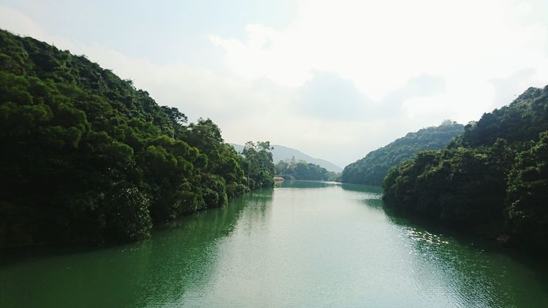 Water Landscape Lake Reflection Tree Blue Arrival Mountain Nature Sky Scenics Adventure Outdoors Extreme Weather No People Day Direction Nature Of Beauty Tai Tam Country Park Reservoir Tai Tam Reservoir Hong Kong Harmony With Nature Beauty In Nature Harmony Of The Seas