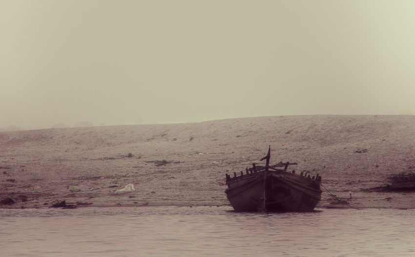 Nautical Vessel Horizon Water Mode Of Transportation Tranquil Scene No People Waterfront Ship Outdoors Tranquility Boat Old Sand Sand Dune Monochrome Low Saturation Beach Riverside