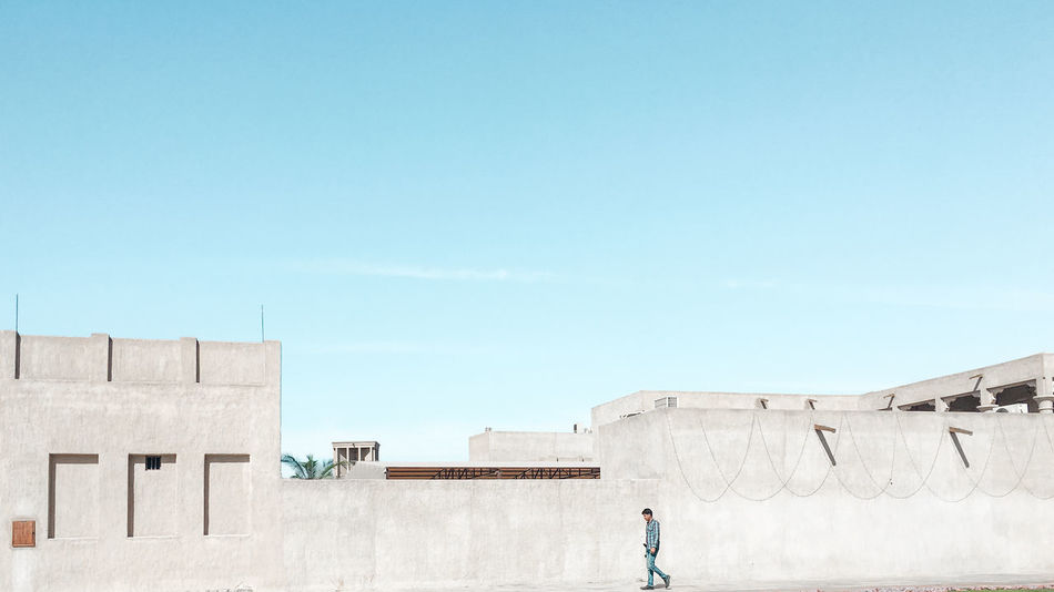 Architecture Building Exterior Built Structure Day Historical Building Manual Worker Men Minimalism Nature Outdoors People Real People Simplicity Sky Sunlight