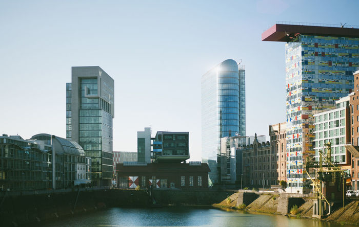 Panorama Architecture Building Exterior Built Structure City Cityscape Clear Sky Day Development Downtown District Düsseldorf, Medienhafen Medienhafen Modern No People Outdoors River Sky Skyscraper Tall Travel Destinations Urban Skyline Water Waterfront