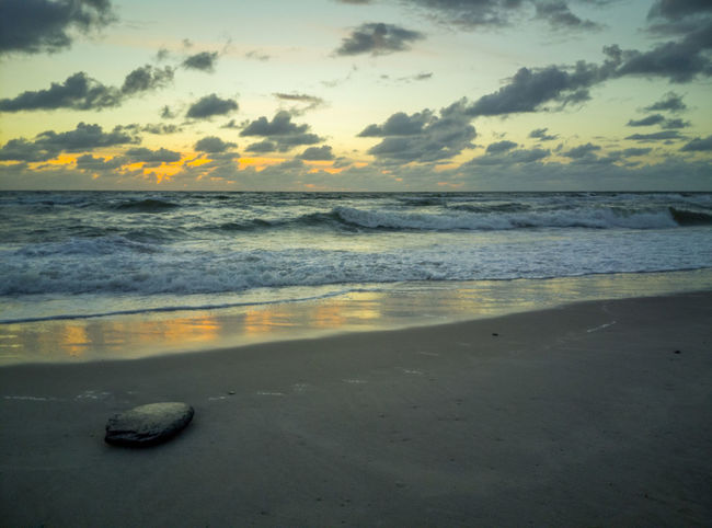 Aquatic Sport Beach Beauty In Nature Cloud - Sky Horizon Horizon Over Water Land Motion Nature No People Outdoors Sand Scenics - Nature Sea Sky Sport Sunset Tranquil Scene Tranquility Water Wave
