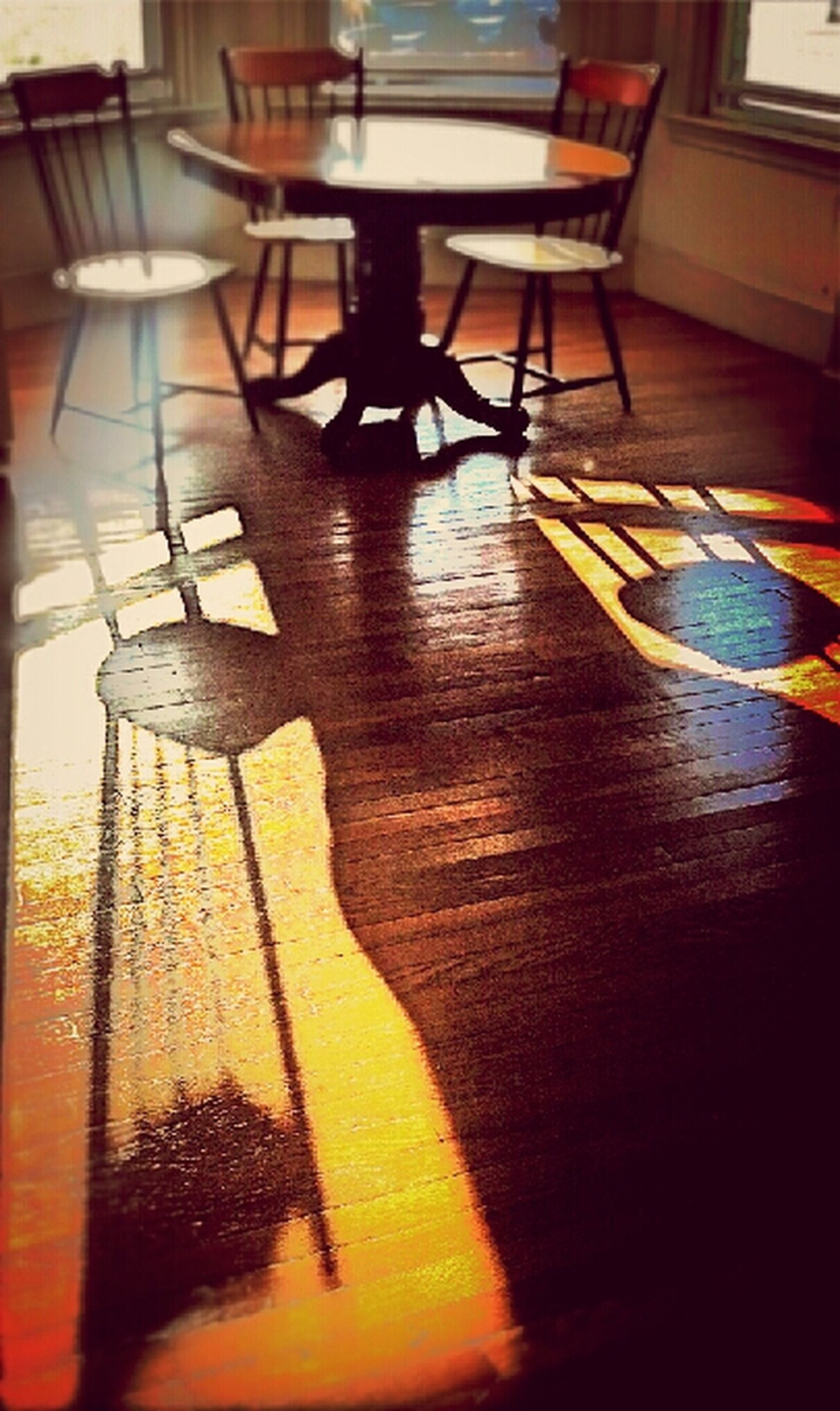 indoors, table, chair, home interior, wood - material, shadow, absence, furniture, high angle view, empty, sunlight, still life, flooring, no people, hardwood floor, electric lamp, wooden, floor, tiled floor, room