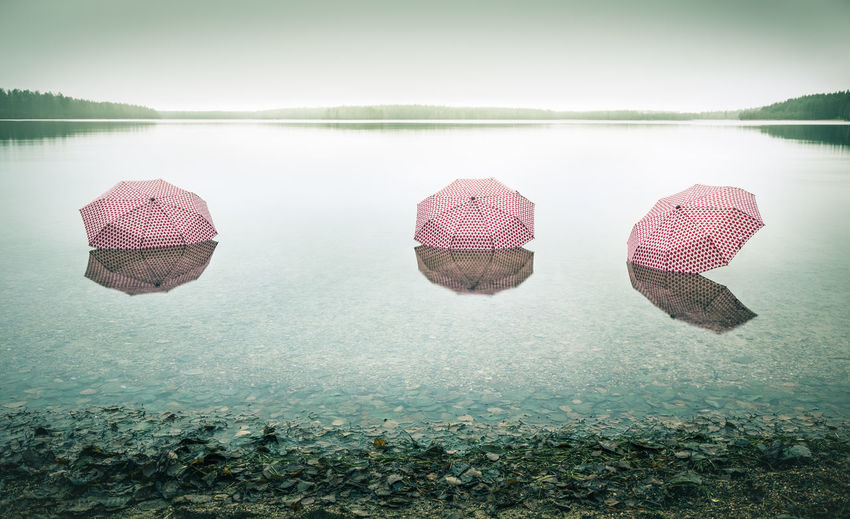 Three umbrellas in shallow water
