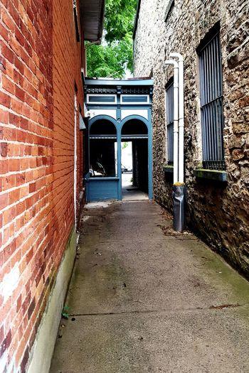 alley between houses Walkway Gananoque, Canada Alley Alleyway Door Architecture Building Exterior Built Structure Brick Wall Archway