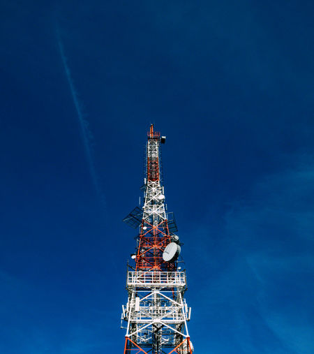 Low angle view of a radio communication tower with a blue sky. Construction Gsm Industry Low Angle View Radio Antenna Blue Sky Broadcasting Communication Day Digital Media Frequency Information Nature No People Outdoors Remote Sky Steel Technology Transmission Tower Wireless Technology
