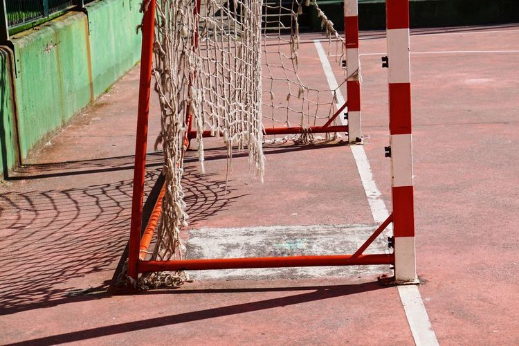 soccer goal sport and rope net in the field in the street Soccer Sport Goal Net Web Rope Field Street Streetphotography Outdoors Sport Equipment Minimalism Old Abandoned Broken Red White