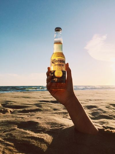 Corona Corona Beer Punta Del Este Beach Sea Sunlight Sand Outdoors Human Hand Nature Vacations Sky Clear Sky Horizon Over Water Day Water