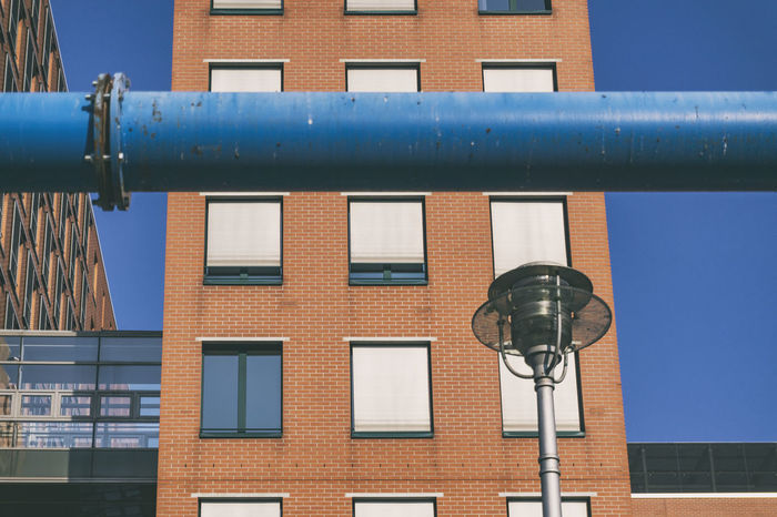 Berlin, Germany, August 02, 2018: Close-Up of Blue Groundwater Pipe and Building in the Background at Potsdamer Platz Berlin Germany 🇩🇪 Deutschland Horizontal Architecture Blue Brick Brick Wall Building Building Exterior Built Structure City Close-up Color Image Day Groundwater Lighting Equipment Low Angle View Metal No People Outdoors Pipe - Tube Residential District Street Sunlight Window