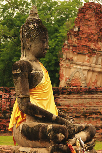 Old Buddha in AYUTTHAYA province, Thailand Old Buddha Old Buddha Ancient Ancient Civilization Architecture Art And Craft Belief Built Structure Day History Human Representation Idol Male Likeness No People Old Buddha Statue Old Buddha Image Outdoors Place Of Worship Religion Representation Sculpture Spirituality Statue Tourism Travel Destinations