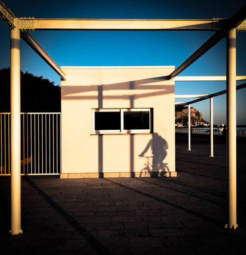 Built structure against clear blue sky at sunset