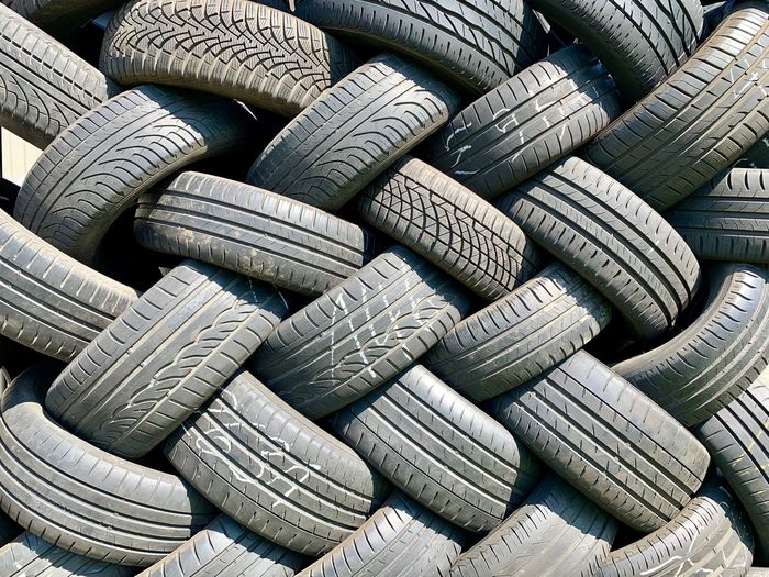 Tire Tires Backgrounds Full Frame Abundance Rubber Tire Large Group Of Objects Stack No People Still Life Wheel Textured  Pattern Day Repetition Arrangement Close-up Outdoors Sunlight Design Black Color
