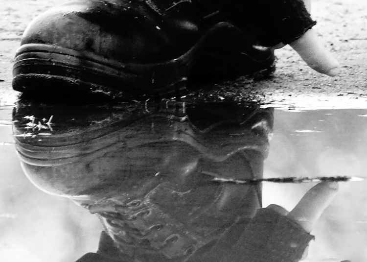 Meaningful  Blackandwhite Blackandwhite Photography One Person Close-up Men Young Adult Human Body Part Human Hand Day Pain Sky Scenics Water Tranquil Scene Low Angle View Focus On Foreground Abstract