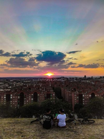 Check This Out Enjoying Life Learn & Shoot: Balancing Elements EyeEm Gallery Sunset And City Sunset_collection Couple People Together Showcase July Cityscape Sunset Madrid Madrid, Spain Cityscapes People Watching Vallecas Parque De Las Siete Tetas SieteTetas Bikes Sunlight Sunlight Through Clouds EyeEm Best Shots Colours In The Sky Rainbow Sky People