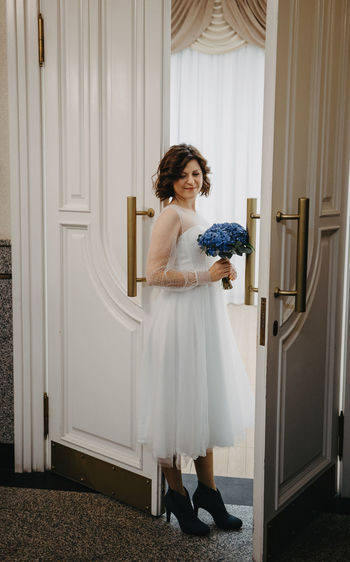 Woman looking at entrance to door