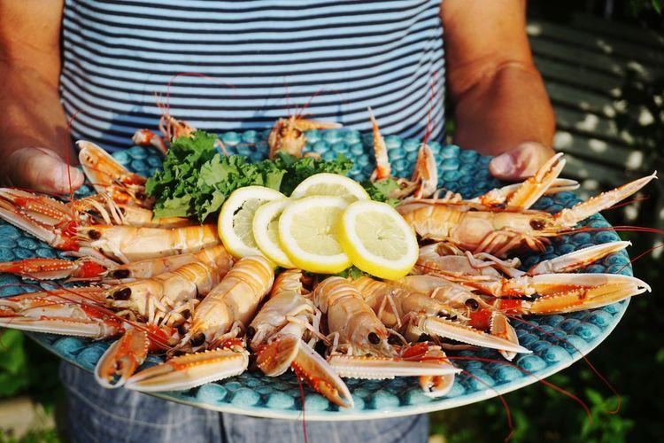 Man serving crayfish