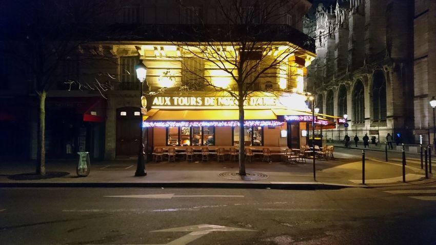 Café at the corner. Paris France Paris ❤ Aux Tours De Notre Dame Notre Dame De Paris Corner Corner Building Corner Cafe Cafe Bistro Bar I Don't Know City Lights City Life Night Lights Night Photography City Illuminated Architecture Built Structure Building Exterior