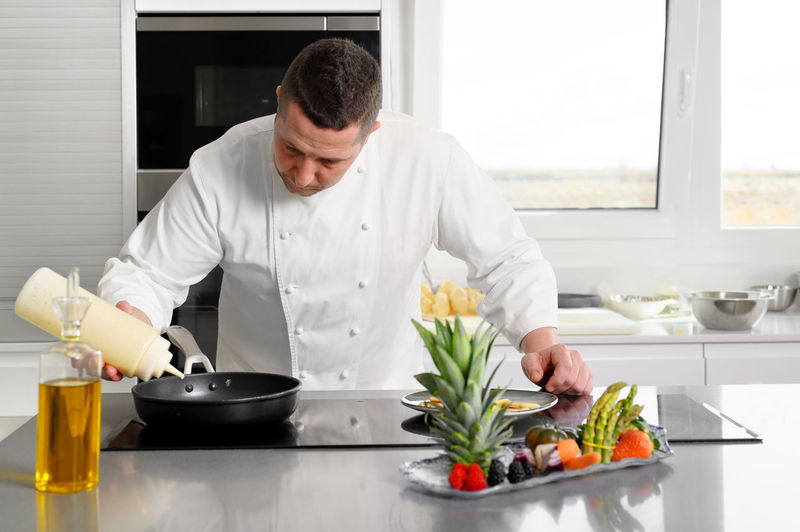 Man preparing food on table