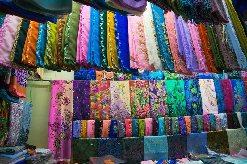 Close up of Colorful Scarfs at market stall Scarf Market Stall Street Market Textile Close Up For Sale Merchandise Retail  Colorful Fashion