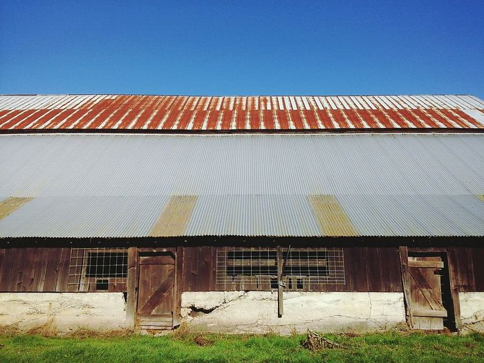 Low Angle View Of Old Barn Against Clear Sky