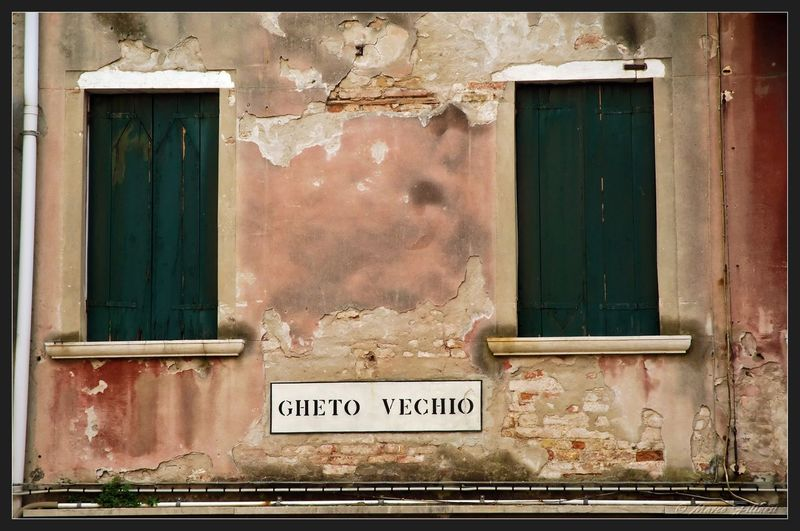 Italia Venezia Abandoned Architecture Building Building Exterior Built Structure Communication Day Deterioration Door Entrance Ghettoscenes Glass - Material House Italy No People Old Outdoors Run-down Text Transfer Print Weathered Western Script Window
