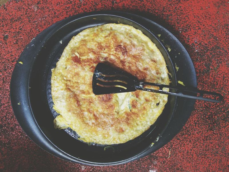 Omelette in frying pan Food And Drink Directly Above Food Close-up No People Table Freshness Ready-to-eat Day Omellete Egg Yolk Fresh Food Photography Cooking Ingredients Healthy Lifestyle Freshness Cooking Time Healthy Food Healthy Eating Egg Asianfood Malaysian Culture Malaysian Food Frying Pan Street Food Worldwide