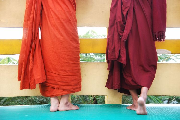 Low section of monks standing at temple