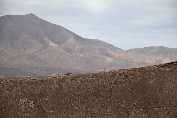 Mountain Scenics - Nature Tranquil Scene Sky Environment Landscape Beauty In Nature Tranquility Non-urban Scene Land Cloud - Sky Day Desert Mountain Range Nature Remote No People Climate Physical Geography Idyllic Arid Climate Outdoors Formation Lanzarote Playa Blanca