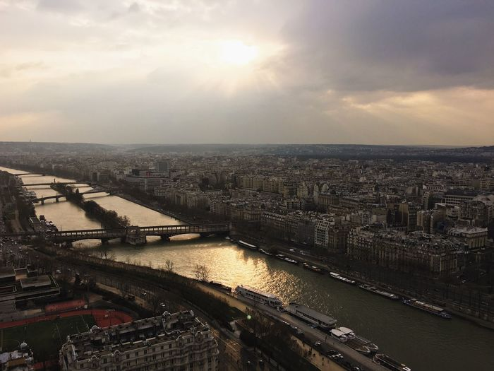 High Angle View Of Seine River Amidst Cityscape Against Sky During Sunset