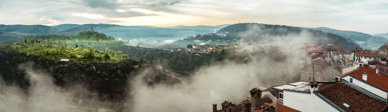 Morning panoramic view over the Veliko Tarnovo city and Tsarevets fortress, Bulgaria Morning Panoramic View Over The Veliko Tarnovo City And Tsarevets Fortress, Bulgaria Veliko Tarnovo Sky Scenics - Nature Mountain Cloud - Sky Architecture Nature Built Structure Environment Beauty In Nature Building Exterior Plant Mountain Range Tree Water Day High Angle View Fog Landscape Tranquil Scene Outdoors Power In Nature The Great Outdoors - 2019 EyeEm Awards