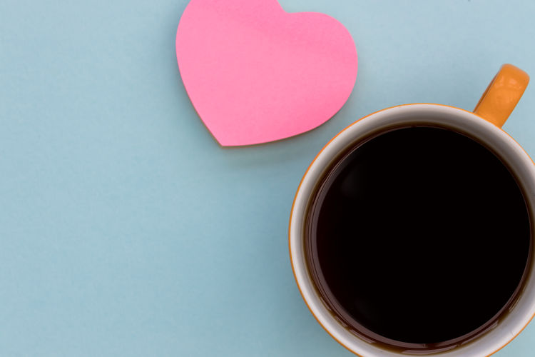 Coffee cup + pink love heart Cup Mug Food And Drink Drink Directly Above Table Coffee Coffee Cup Still Life Indoors  Copy Space Refreshment Pink Love Heart Shape Top View From Above  Overhead View Background Minimal Flat Lay Coffee - Drink Blue Background Pink Color Black Coffee Freshness Tea Cup Studio Shot