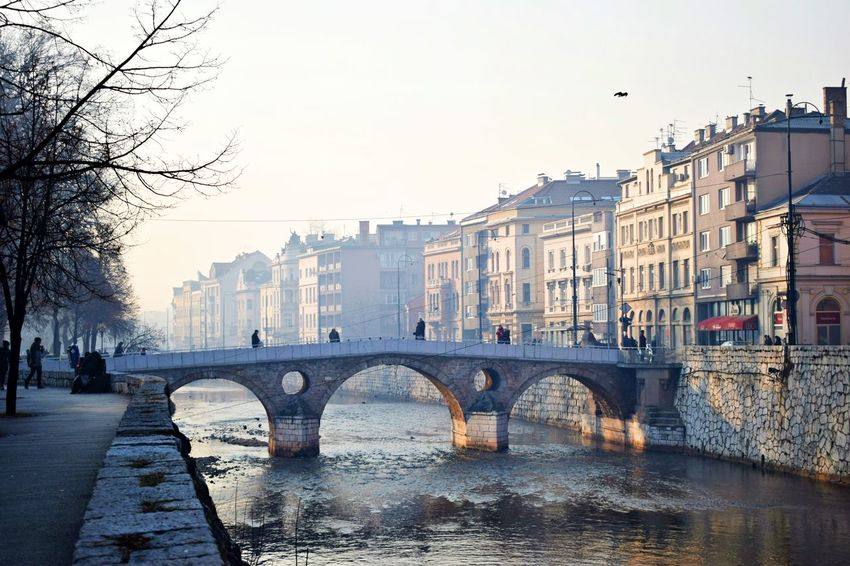 Architecture Bridge - Man Made Structure Building Exterior Buildings Built Structure City Cityscape Connection Day Daylight Foggy Foggy Day Morning No People Old Buildings Old But Awesome Old Town Outdoors River Sarajevo Sky Smog Travel Destinations Water Wintertime The City Light