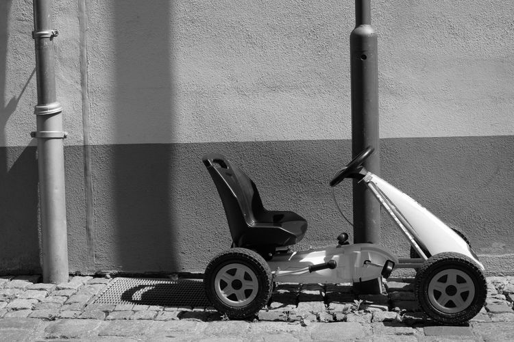 Toy car against wall