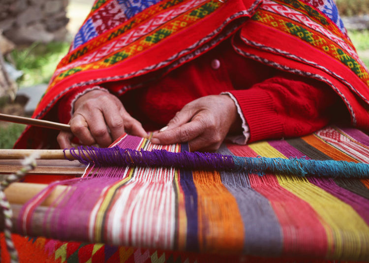 Casual Clothing Close-up Colorful Craft Cropped Culture Colour Of Life Day Focus On Foreground Hands At Work Indigenous  Leisure Activity Lifestyles Multi Colored Outdoors Part Of Peru Peruvian Red Skill  South America Traditional Traditional Clothing Travel Weaving