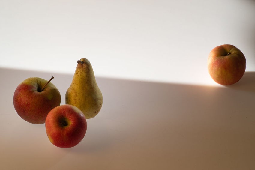 Practising with light and composition Composition Apple - Fruit Copy Space Day Focus On Foreground Food And Drink Fruit Group Of Objects Healthy Eating Indoors  Light And Shadow Light Table No People Pear Practise Practise Session Rule Of Odds Still Life Studio Shot Table Three Objects