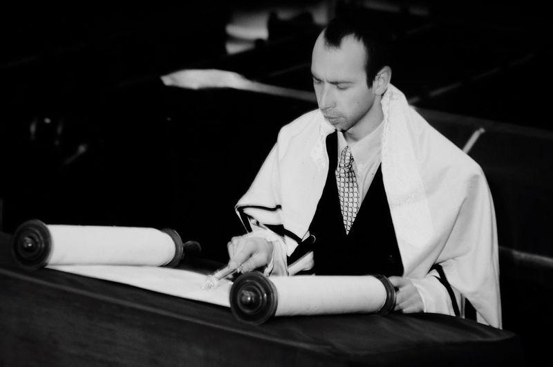 Close-up of a man reading torah