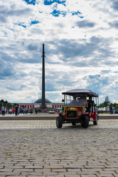 Поклонная гора Architecture Car Cloud - Sky Cobblestone Day EyeEm Selects Land Vehicle Memorial Obelisk Outdoors Park Public Places Sky Tourist Tourists Transportation Mobility In Mega Cities