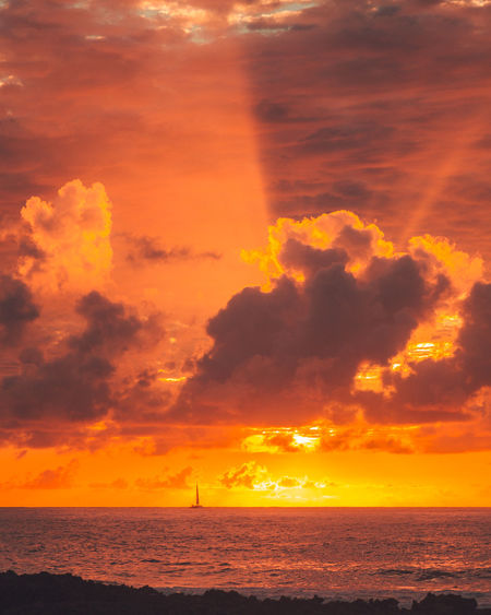 Hawaii has one of the best sunsets i have ever experienced. One this one particular evening i got the chance to capture this epic sunset with a sail boat. Gosh how i wish i was on that sail boat! Beauty In Nature Cloud - Sky Dramatic Sky Horizon Horizon Over Water Idyllic Nature No People Orange Color Outdoors Scenics - Nature Sea Sky Sun Sunlight Sunset Tranquil Scene Tranquility Water