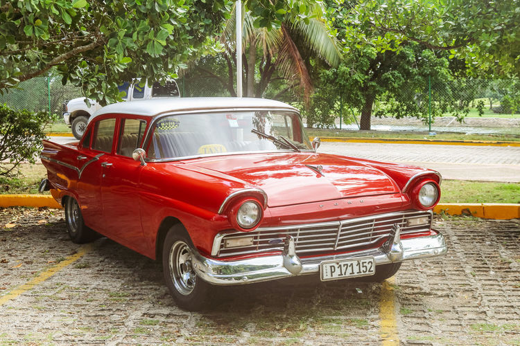 Vintage red ford taxi on parking lot, Cuba, Varadero, 4 November 2016 Mode Of Transportation Tree Transportation Red Car Motor Vehicle No People Outdoors Retro Styled Day Land Vehicle Nature Taxi Ford Vintage Vintage Car Cuba Varadero Cuba. Varadero Travel Luxury