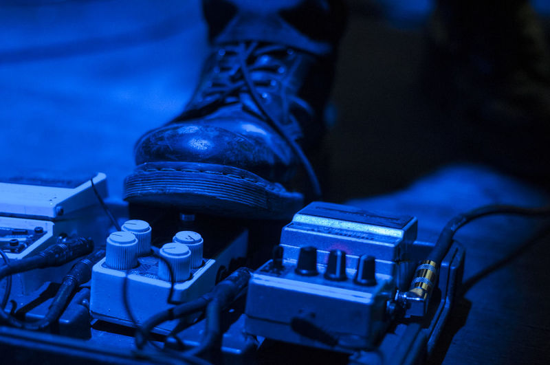 Close-up of shoe by machine part