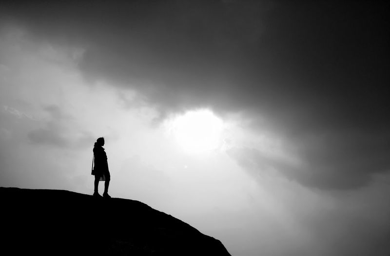 38. A girl standing at the edge of the hill all alone and looking down at the abyss. Clicked on 17.09.2017 at Tagore Hill, Ranchi, Jharkhand (India). Camera: Xiaomi Redmi Note 4. Silhouette Full Length One Person Adult Adventure Standing Adults Only Outdoors Sky Young Adult Nature Hills Tagore Hill Ranchi, Jharkhand Sun The Week On EyeEm Done That. HUAWEI Photo Award: After Dark