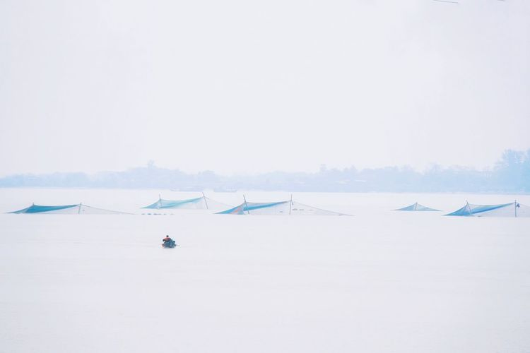 Rowing in the River Sea Beach Mountain Water Flamingo Blue Sky Fishing Net Fishing Industry Fishing Tackle Fishing Boat The Traveler - 2019 EyeEm Awards