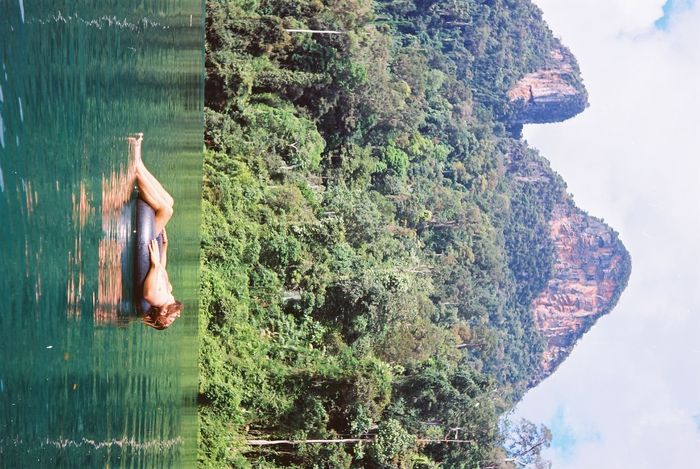 Film Tailandia Thailand Travel Traveling Beauty In Nature Film Photography Filmisnotdead Floating Floating In Water Floating On Water Jungle Kao Sok Kao Sok National Park Kaosok Lifestyles Mountain Nature One Person Outdoors Real People Selva Shirtless Tranquility Water
