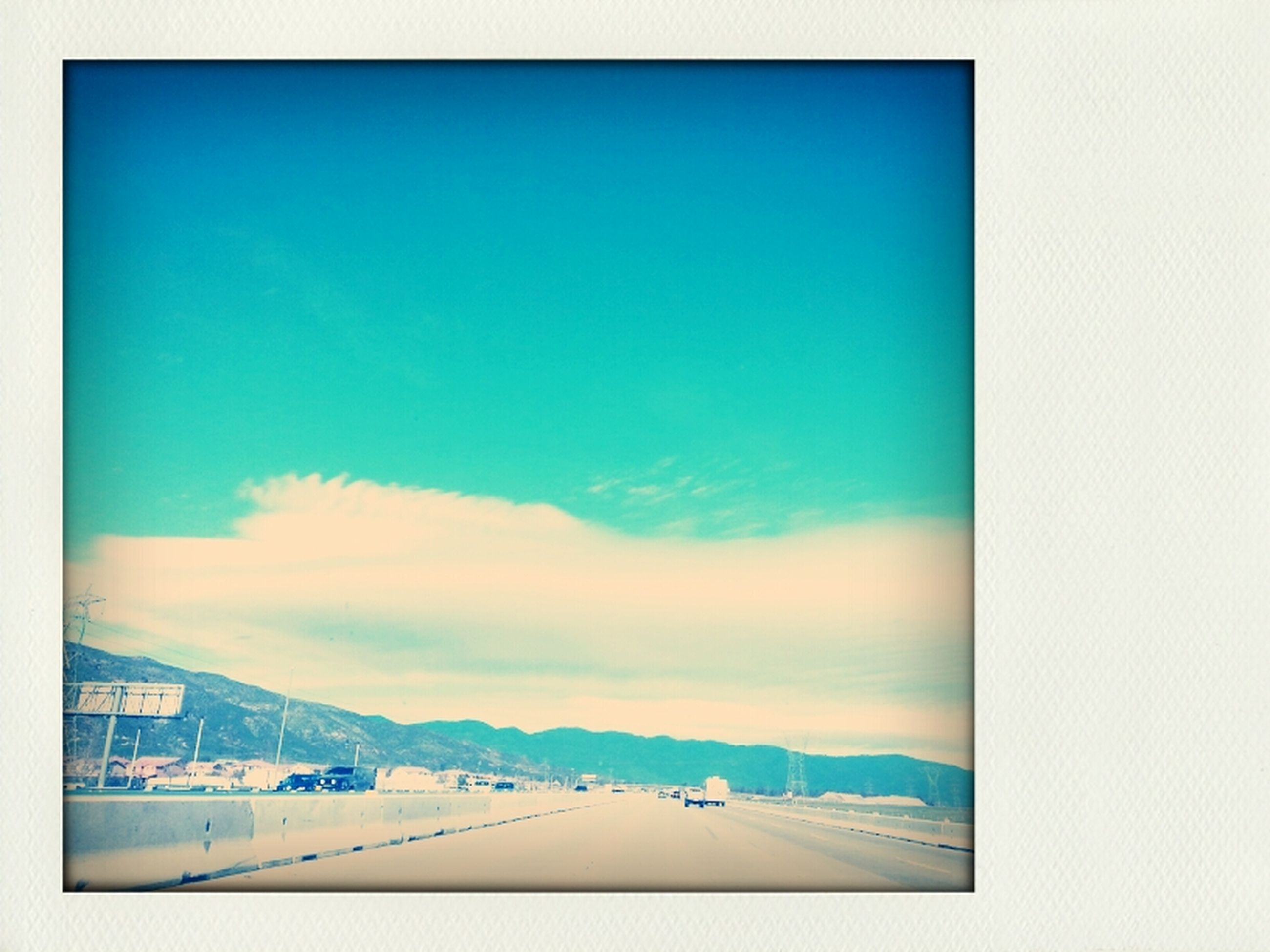 sky, transfer print, auto post production filter, blue, transportation, scenics, mountain, beauty in nature, copy space, tranquil scene, nature, tranquility, cloud - sky, cloud, day, landscape, outdoors, road, no people, travel