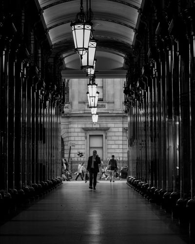 When the store is shut all you can do is stroll. Indoors  Full Length Architecture People Day Canon Streetphotography @canonuk Canonuk Canon5D London Canon5dmarkiv Liveforthestory Architecture City Street Burlingtonarcade Built Structure Adult Monochrome Blackandwhite Black And White Contrast Contrast And Lights Photo24