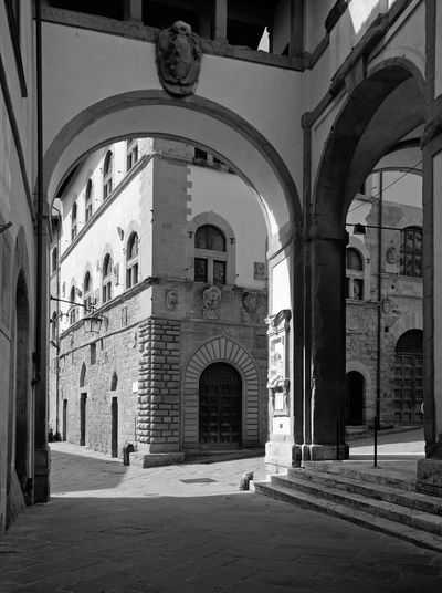 typical beautiful street view in the historic center of Arezzo, with its ancient building and stone arches in Renaissance style Colonnade Arch Arezzo Architecture Built Structure Building Exterior The Past History Architectural Column Arched Outdoors Arcade No People Day Black And White Photography Black And White Light And Shadow Street Architecture EyeEmNewHere EyeEm Best Edits