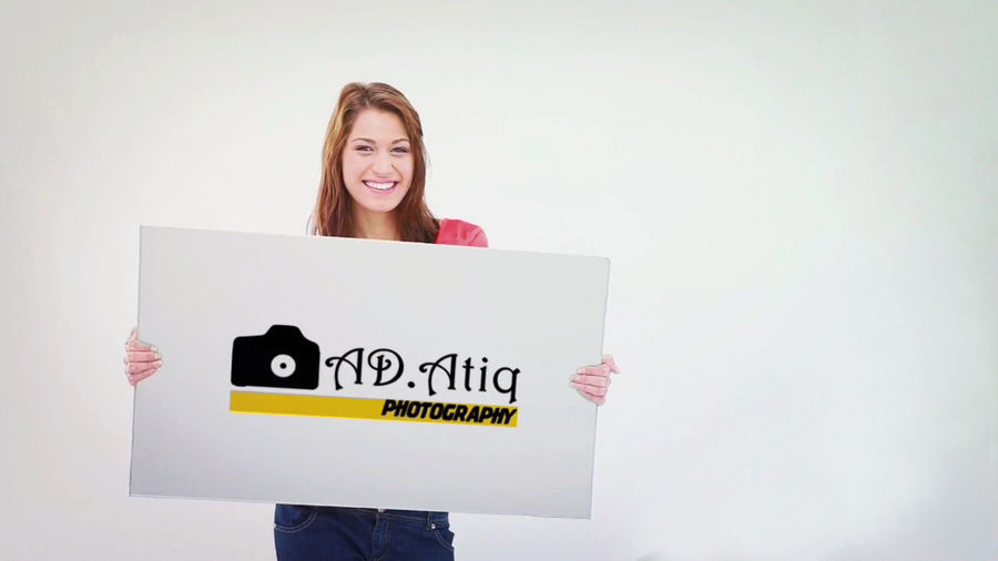 Ad.Atiq Photopgaphy Founded by Atiq Adnan Communication One Person Young Adult Front View Indoors  Copy Space Holding Young Women Text Smiling Emotion Studio Shot Sign Standing Western Script Looking At Camera Happiness Women Casual Clothing Message Hairstyle Beautiful Woman Ad.Atiq Photography Atiq Adnan Phtography