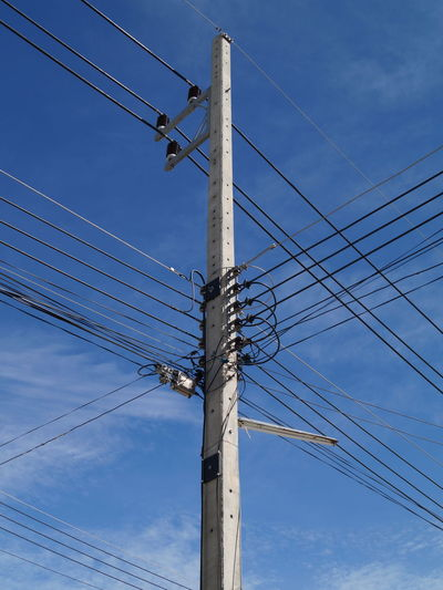 Low angle view of telephone line against sky