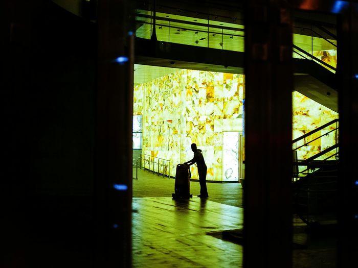Silhouette man in corridor
