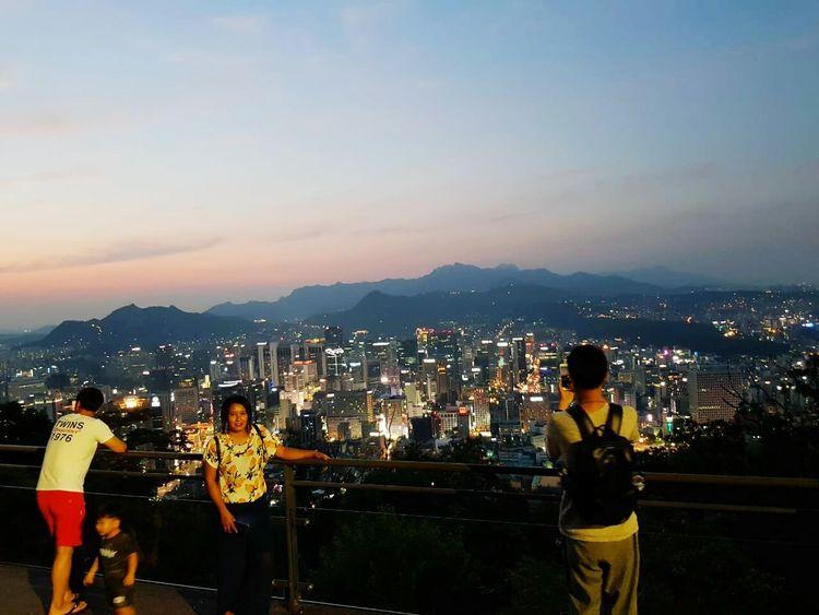 City Cityscape Urban Skyline Skyscraper Illuminated Standing Women Young Women Mountain Sky