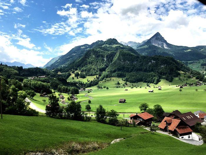 瑞士自然风光 EyeEm Selects Mountain Cloud - Sky Sky Grass Nature Beauty In Nature Mountain Range Outdoors Green Color Landscape Golf No People Field